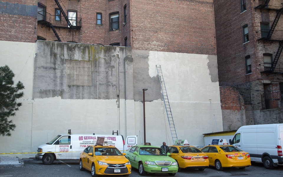Mike Hewson: (Unannounced removal of sign and painting of wall) - McDonald's Parking Lot, 125th St and Broadway, Harlem