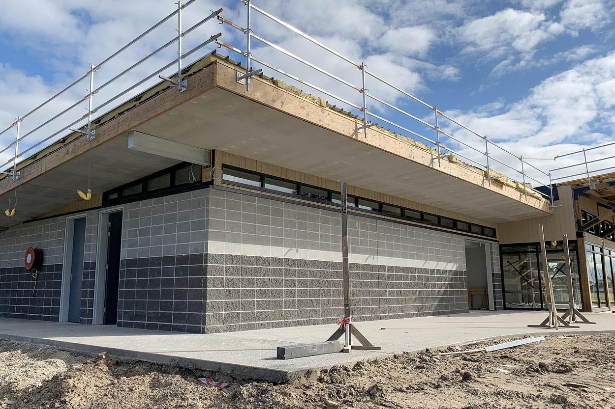 Mike Hewson: (Context: Adjacent cricket pavilion building under construction) -